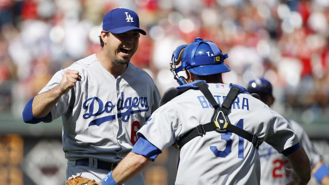 Los Angeles Dodgers starting pitcher Josh Beckett, left, celebrates with catcher Drew Butera after striking out Philadelphia Phillies' Chase Utley looking for a no-hitter baseball game, Sunday, May 25, 2014, in Philadelphia. Los Angeles won 6-0