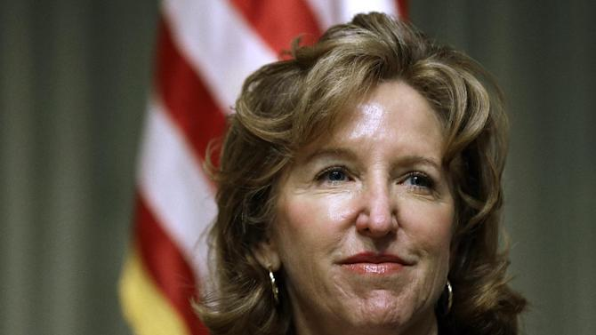 FILE - In this Wednesday, April 16, 2014 file photo, Sen. Kay Hagan, D-N.C., listens during an appearance in Durham, N.C. The Democratic Party's control of the U.S. Senate after the general election in November could lie in the fortunes of female candidates and the deep-pocketed donors, like former New York Mayor Michael Bloomberg, who are sending piles of cash their way. Hagan in North Carolina and Jeanne Shaheen in New Hampshire face heavy outside spending but have Emily's List backing. (AP Photo/Gerry Broome, File)