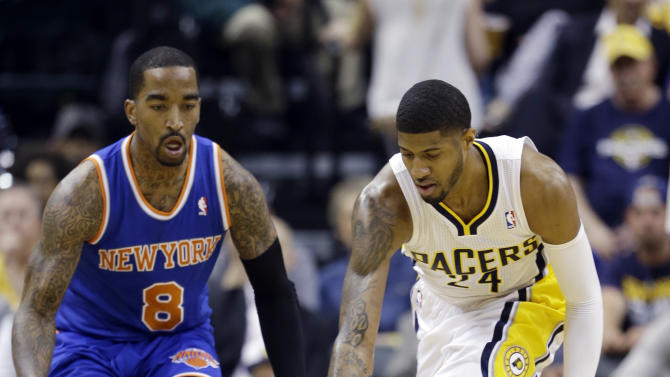 Indiana Pacers' Paul George (24) grabs a loose ball in front of New York Knicks' J.R. Smith (8) during the first half of Game 4 of an Eastern Conference semifinal NBA basketball playoff series on Tuesday, May 14, 2013, in Indianapolis. (AP Photo/Darron Cummings)