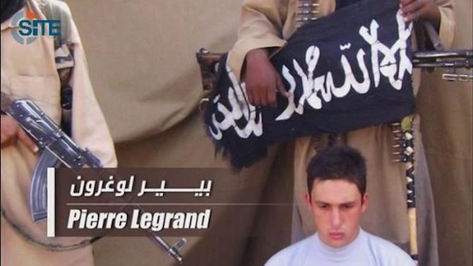 In this image taken from video and released by SITE  Intelligence Group on Wednesday April 27, 2011, shows hostage Pierre Legrand. The French government said Wednesday officials are working to verify the authenticity and date of new online video showing four French hostages held by al-Qaida's north Africa branch. SITE Intelligence Group, a U.S.-based tracker of extremist websites, says the 3 1/2-minute video was posted on jihadist forums on Tuesday. There has been very little sign of life from the hostages since they were kidnapped in September 2010 in Niger. Al-Qaida in the Islamic Maghreb claimed responsibility for the kidnapping seven hostages including Pierre Legrand. (AP Photo/SITE. Ho)