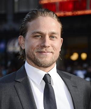 "Actor Charlie Hunnam arrives on the red carpet at the season six premiere screening of the television series ""Sons of Anarchy"" at the Dolby Theatre on Saturday, Sept. 7, 2013 in Los Angeles. (Photo by Dan Steinberg/Invision/AP)"