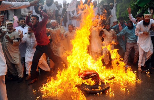 "Pakistani Sunni Muslims torch a US flag during a protest against an anti-Islam movie in Lahore on September 17, 2012.  Two protesters died in Pakistan as a violent backlash against a US film mocking Islam spread across the region and angry demonstrators clashed with police, hurled stones and shouted """"Death to America"". AFP PHOTO/ Arif Ali"