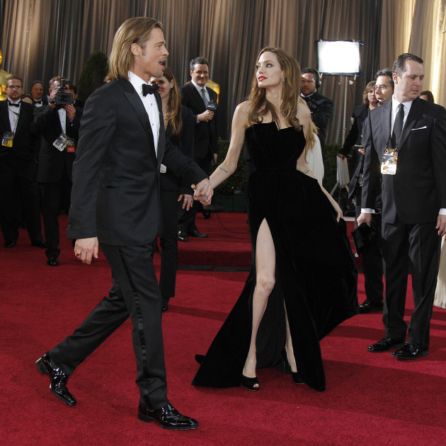 Actress Angelina Jolie, right, and actor Brad Pitt arrive before the 84th Academy Awards on Sunday, Feb. 26, 2012, in the Hollywood section of Los Angeles. (AP Photo/Amy Sancetta)