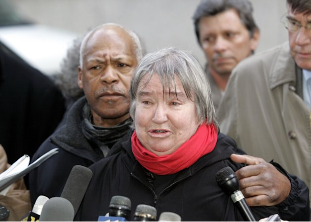 FILE - In this Feb. 10, 2005 file photo, attorney Lynne Stewart cries as she speaks to the press with her husband Ralph Pointer next to her, left, outside Federal Court in New York after she was convi