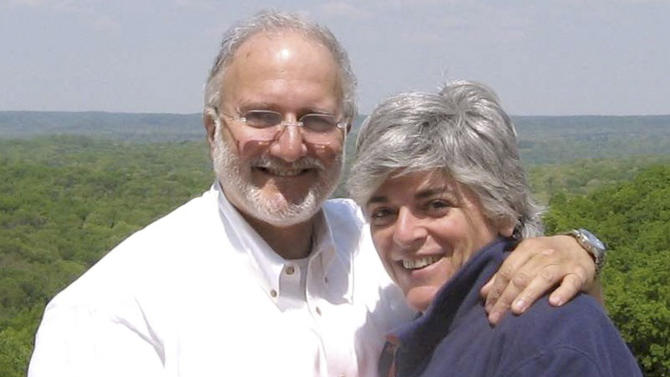 FILE - In this file photo provided by the Gross family shows Alan and Judy Gross are sen in an unknown location. A doctor says an American man imprisoned in Cuba may have a cancerous growth on his shoulder, contradicting the Cuban government's stance that his health is normal. A lawyer for Alan Gross said Tuesday in a statement that an independent physician reviewed medical records sent by Cuba. The doctor says that the mass must be assumed to be cancerous unless proven otherwise. (AP Photo/Gross Family, File)