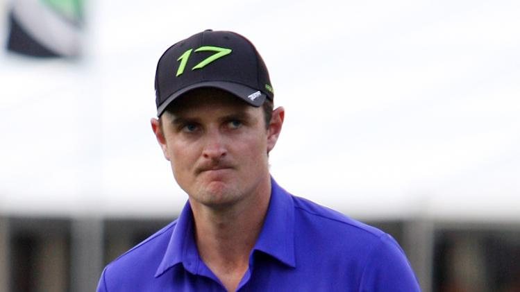 Justin Rose, of England, pumps his fist after his putt on the 18th hole during the final round of the Cadillac Championship golf tournament on Sunday, March 11, 2012, in Doral, Fla. (AP Photo/Lynne Sladky)