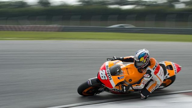 Spanish Moto GP rider Dani Pedrosa of the Repsol Honda Team powers his bike on the second day of the pre-season test at the Sepang circuit outside Kuala Lumpur (AFP)