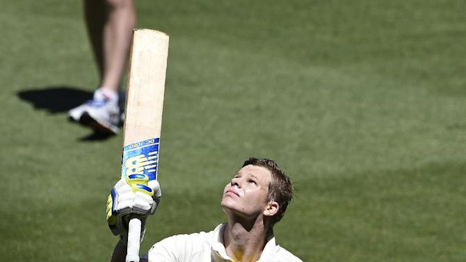 Australia's Steve Smith raises his bat as he walks off after he is bowled out for 192 runs against India on the second day of their cricket test match in Melbourne, Australia, Saturday, Dec. 27, 2014. Australia are all out for 530 in their first innings. (AP Photo/Andy Brownbill)