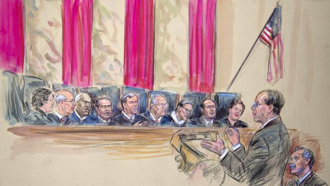 This artist rendering shows Paul Clement, second from left, with Solicitor General Donald B. Verrilli Jr. seated, right, addresses the Supreme Court in Washington, Wednesday, March 27, 2013, as the court heard arguments on the Defense of Marriage Act (DOMA) case. Justices, from left are, Sonia Sotomayor, Stephen Breyer, Clarence Thomas, Antonin Scalia, Chief Justice John Roberts, and Justices Anthony Kennedy, Ruth Bader Ginsburg, Samuel Alito and Elena Kagan. (AP Photo/Dana Verkouteren)