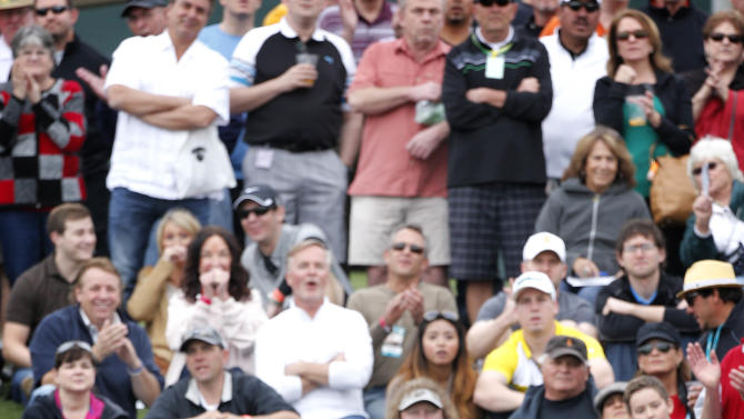 Phil Mickelson watches his ball take flight from the 10th tee as crowds watch during the final round of the Waste Management Phoenix Open golf tournament on Sunday, Feb. 3, 2013, in Scottsdale, Ariz. Mickelson won the tournament. (AP Photo/Matt York)