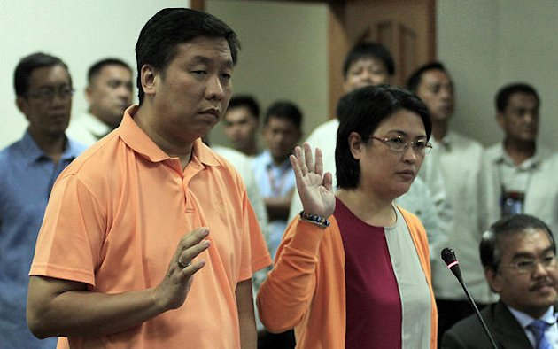 Mr. Reynaldo and Annaliza Marzan take their oaths before the Senate Committee on Labor during the Senate investigation on their alleged maltreatment of their former kasambahay Bonita Baran, held at the Senate in Pasay City, south of Manila, on 12 September 2012. (Joseph Vidal/SENATE-PRIB/NPPA Images)