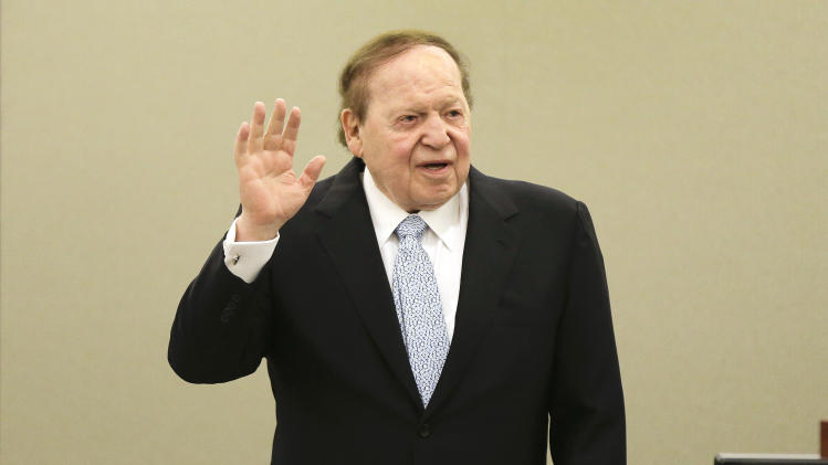 Las Vegas Sands Corp. CEO Sheldon Adelson is sworn in before taking the witness stand, Thursday, April 4, 2013, in Las Vegas. The casino billionaire and GOP super-donor made a rare public appearance as the lead witness against a Hong Kong businessman who is suing his company for $328 million. (AP Photo/Julie Jacobson)