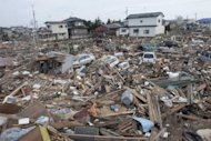 Tsunami debris are scattered over a devastated area of Sendai, 2011. Catastrophes like Japan's 2011 tsunami cost the world more than $3.5 trillion over the last 30 years, a conference heard, as the World Bank called for better disaster planning