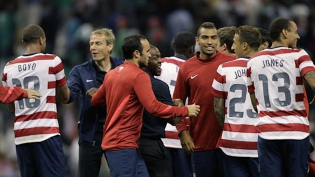Jurgen Klinsmann (2nd L) celebrates with his US players (Reuters)