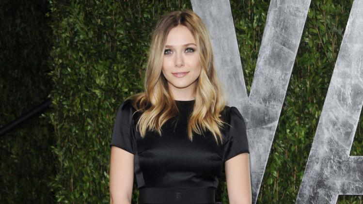"FILE - This Feb. 26, 2012 file photo shows actress Elizabeth Olsen arrives at the Vanity Fair Oscar party in West Hollywood, Calif. Olsen will soon be a star-crossed lover _ she'll star in an off-Broadway version of Shakespeare's ""Romeo & Juliet."" Classic Stage Company said Thursday that the younger sister of Mary-Kate and Ashley Olsen will help will kick off their 2013/2014 season. (AP Photo/Evan Agostini, file)"