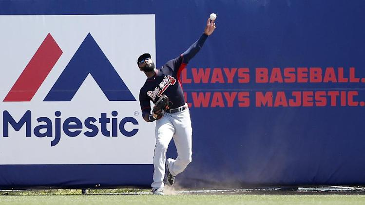 Atlanta Braves right fielder Jason Heyward relays the ball on New York Yankees' Ichiro Suzuki's first-inning double in a spring exhibition baseball game in Tampa, Fla., Sunday, March 16, 2014