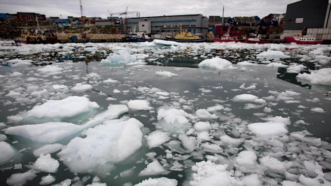 In this July 18, 2011 photo, floating ice fills a harbor, left over from broken-up icebergs shed from the Greenland ice sheet, in Ilulissat, Greenland. (AP Photo/Brennan Linsley)