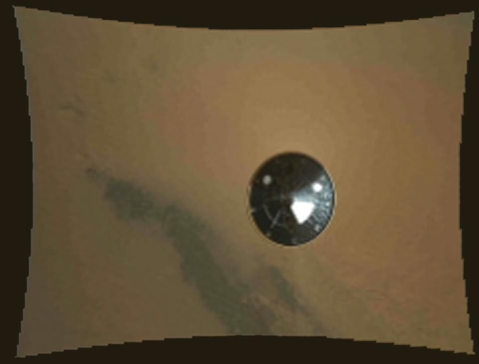 In this frame provided by NASA of a stop motion video taken during the NASA rover Mars landing, the heat shield falls away during Curiosity's descent to the surface of Mars on Sunday, Aug. 5, 2012. (AP Photo/NASA/JPL-Caltech/MSSS)