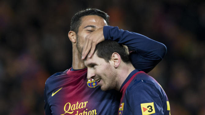 FC Barcelona's Lionel Messi, from Argentina, right, is congratulated by teammate Thiago Alcantara after scoring against Atletico Madrid during a Spanish La Liga soccer match at the Camp Nou stadium in Barcelona, Spain, Sunday, Dec. 16, 2012, (AP Photo/Bernat Armangue)