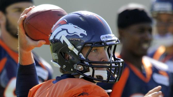 Denver Broncos quarterback Tim Tebow (15) throws during football practice at the team's training facility, Tuesday, Oct. 11, 2011, in Englewood, Colo.  (AP Photo/Jack Dempsey)