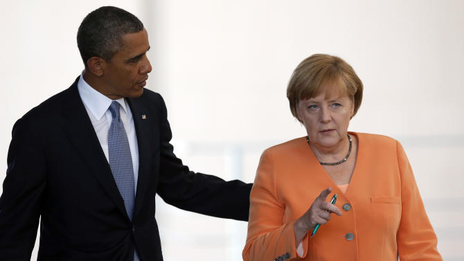 FILE - In this June 19, 2013, file photo, President Barack Obama, left, and German Chancellor Angela Merkel, right, arrive for a news conference at the chancellery in Berlin. Reports based on leaks from former NSA systems analyst Edward Snowden suggest the U.S. has monitored the telephone communications of 35 foreign leaders. The fact that Merkel was among them has been particularly troubling to many in Europe and on Capitol Hill, given her status as a senior stateswoman, the leader of Europe's strongest economy, and a key American ally on global economics, Iranian nuclear negotiations and the Afghanistan war. (AP Photo/Michael Sohn, File)