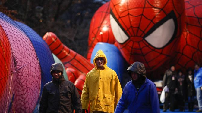 Members of the Macy's Thanksgiving Day Parade balloon inflation team check balloons during preparations for the 88th annual Macy's Thanksgiving Day Parade in New York