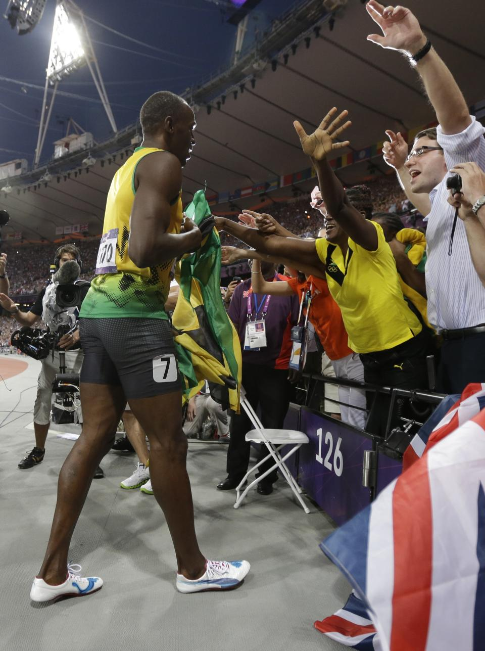 Jamaica's Usain Bolt celebrates winning the men's 200-meter final during the athletics in the Olympic Stadium at the 2012 Summer Olympics, London, Thursday, Aug. 9, 2012. (AP Photo/Matt Rourke)