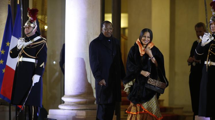 Chad's President Idriss Deby and his wife Hinda Deby arrive for a dinner with the French President and other dignitaries as part of the Summit for Peace and Security in Africa at the Elysee Palace in Paris