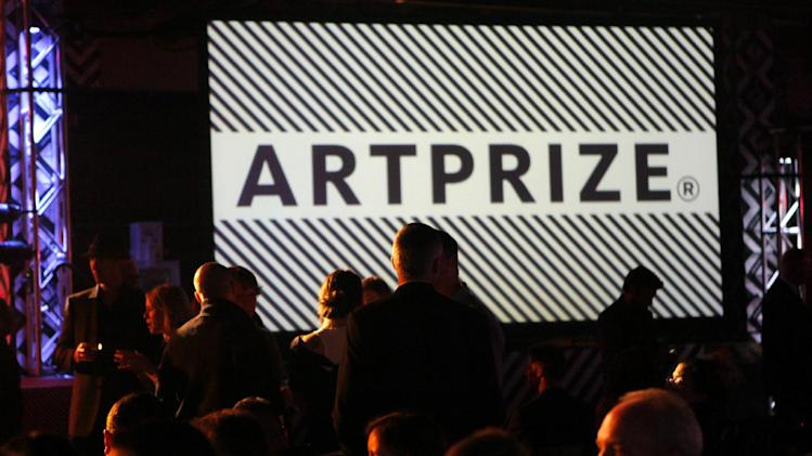 Crowds mingle at the fourth annual ArtPrize awards on Friday, Oct. 5 , 2012  in Grand Rapids, Mich. The annual art competition began Sept. 19. This year's installment features entries from 1,517 artists from 56 countries and 45 states. The works are on display at dozens venues across downtown Grand Rapids. A list of the 10 finalists for the public vote was earlier announced by organizers. (AP Photo/The Grand Rapids Press, Emily Zoladz) ALL LOCAL TV OUT; LOCAL TV INTERNET OUT