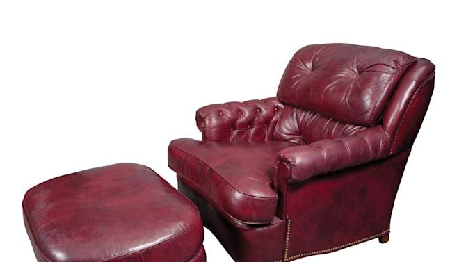 This undated photo provided by Doyle New York shows a burgundy leather club chair and ottoman which belonged to former Mayor Ed Koch, and sold last week. The former mayor's letters and books are going on the auction block. Doyle New York has estimated most of them will sell for between $200 and $500 on Monday, Nov. 25, 2013. (AP Photo/Doyle New York)