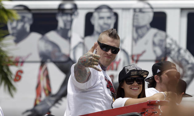 NBA champion Miami Heat's Chris Andersen gestures to fans during a parade honoring the team in Miami, Monday, June 24, 2013. (AP Photo/Javier Galeano)
