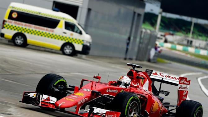 NSZ010. Sepang (Malaysia), 28/03/2015.- German Formula One driver Sebastian Vettel of Scuderia Ferrari arrives at the parc ferme at the end of qualifying at the Sepang Circuit in Sepang, Malaysia, 28 March 2015. The 2015 Formula One Grand Prix of Malaysia will take place on 29 March. (Malasia) EFE/EPA/DIEGO AZUBEL