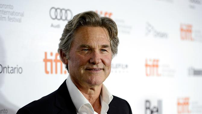 "FILE - This Sept. 11, 2013 file photo, Actor Kurt Russell arrives at the premiere of ""The Art of the Steal"" on day 7 of the Toronto International Film Festival in Toronto. Calling his late cast mate Paul Walker ""a terrific guy,"" Russell says he's not sure what will happen with his role in the latest ""Fast & Furious"" movie. Russell joined the seventh film in the franchise and plays a father figure to Vin Diesel's character Dominic Toretto. The 62-year-old actor said he had one day left of filming when Walker died in a car crash outside Los Angeles last November. (Photo by Chris Pizzello/Invision/AP)"