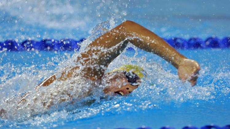 Tankrit Kattiya of Thailand competes during the men's 4x200m Freestyle Relay final at the 27th SEA Games in Naypyitaw
