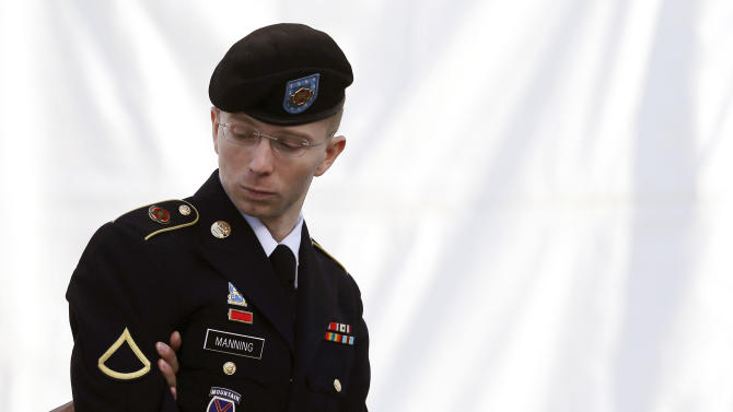 AP10ThingsToSee - Army Pfc. Bradley Manning is escorted into a courthouse in Fort Meade, Md., Wednesday, June 5, 2013, on the third day of his court martial. Manning is charged with indirectly aiding the enemy by sending troves of classified material to WikiLeaks. He faces up to life in prison. (AP Photo/Patrick Semansky, File)