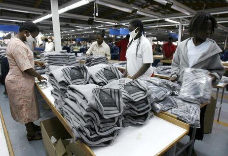 Kenyan workers pack clothes for export at the Alltex EPZ factory in Athi River Kenya