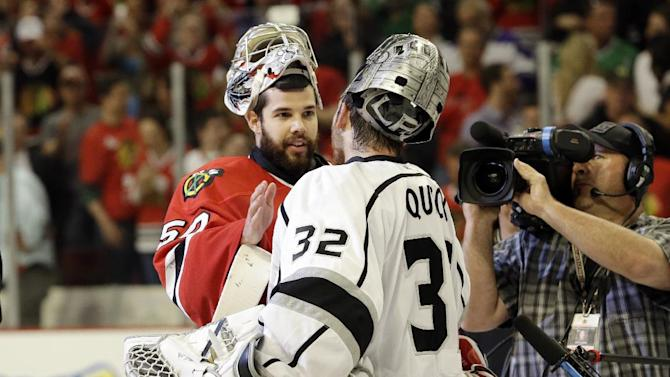 Los Angeles Kings goalie Jonathan Quick (32) congratulates Chicago Blackhawks goalie Corey Crawford (50) for Blackhawks' 4-3 win over Los Angeles Kings in the second overtime period in Game 5 of the NHL hockey Stanley Cup playoffs Western Conference finals, Saturday, June 8, 2013, in Chicago. The Blackhawks advance to the Stanley Cup finals. (AP Photo/Nam Y. Huh)