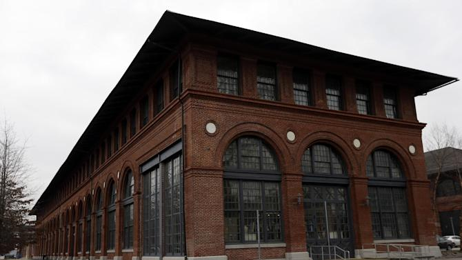 In this Wednesday, Feb. 6, 2013 photo, shown is an Urban Outfitters building at the Navy Yard in Philadelphia. The city's Navy Yard is celebrating a milestone that skeptics might not have believed 15 years ago. Nearly all naval operations are long gone from the sprawling former shipyard but 10,000 people now work there in an eclectic mix of businesses from fashion to pharmacies. That number is expected to triple in 20 years. (AP Photo/Matt Rourke)