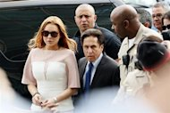 Actress Lindsay Lohan arrives with Attorney Mark Heller for court at the Airport Branch of the Los Angeles Superior Courthouse in Los Angeles, California March 18, 2013. REUTERS/Patrick T. Fallon