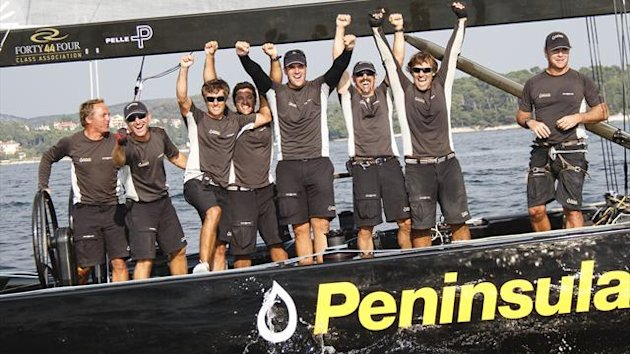 Peninsula Petroleum's crew celebrate winning the 2012 RC44 sailing World Championship in Rovinj, Croatia, on October 7