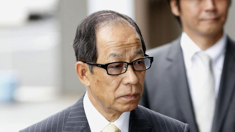 Former Olympus Corp. President Tsuyoshi Kikukawa arrives at the Tokyo District Court in Tokyo Wednesday, July 3, 2013. The court has convicted Kikukawa and two executives for covering up massive investment losses at the Japanese camera and medical equipment company. The court ordered prison terms of three years to Kikukawa and an auditor, and two-and-half years to a third executive — all suspended up to five years, meaning they won't be jailed. Olympus was fined 700 million yen ($7 million). (AP Photo/Kyodo News) JAPAN OUT, MANDATORY CREDIT