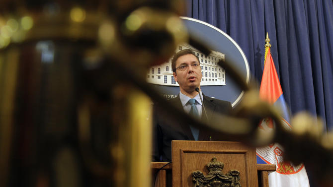 Serbian First Deputy Prime Minister and Defense Minister Aleksandar Vucic speaks during a news conference, in Belgrade, Serbia, Thursday, Nov. 29, 2012. A U.N. war crimes tribunal on Thursday acquitted the former prime minister of Kosovo Ramush Haradinaj and two of his former Kosovo Liberation Army comrades for the second time ofmurdering and torturing Serbs and their supporters in Kosovo's war for independence. Serbian officials and media had been anticipating for days that Haradinaj would be acquitted less than two weeks after two Croatian generals were cleared of charges of killing and deporting Serbs in a 1995 military blitz, a judgment that sparked rage in Belgrade, where many see the tribunal as anti-Serb. (AP Photo/Darko Vojinovic)