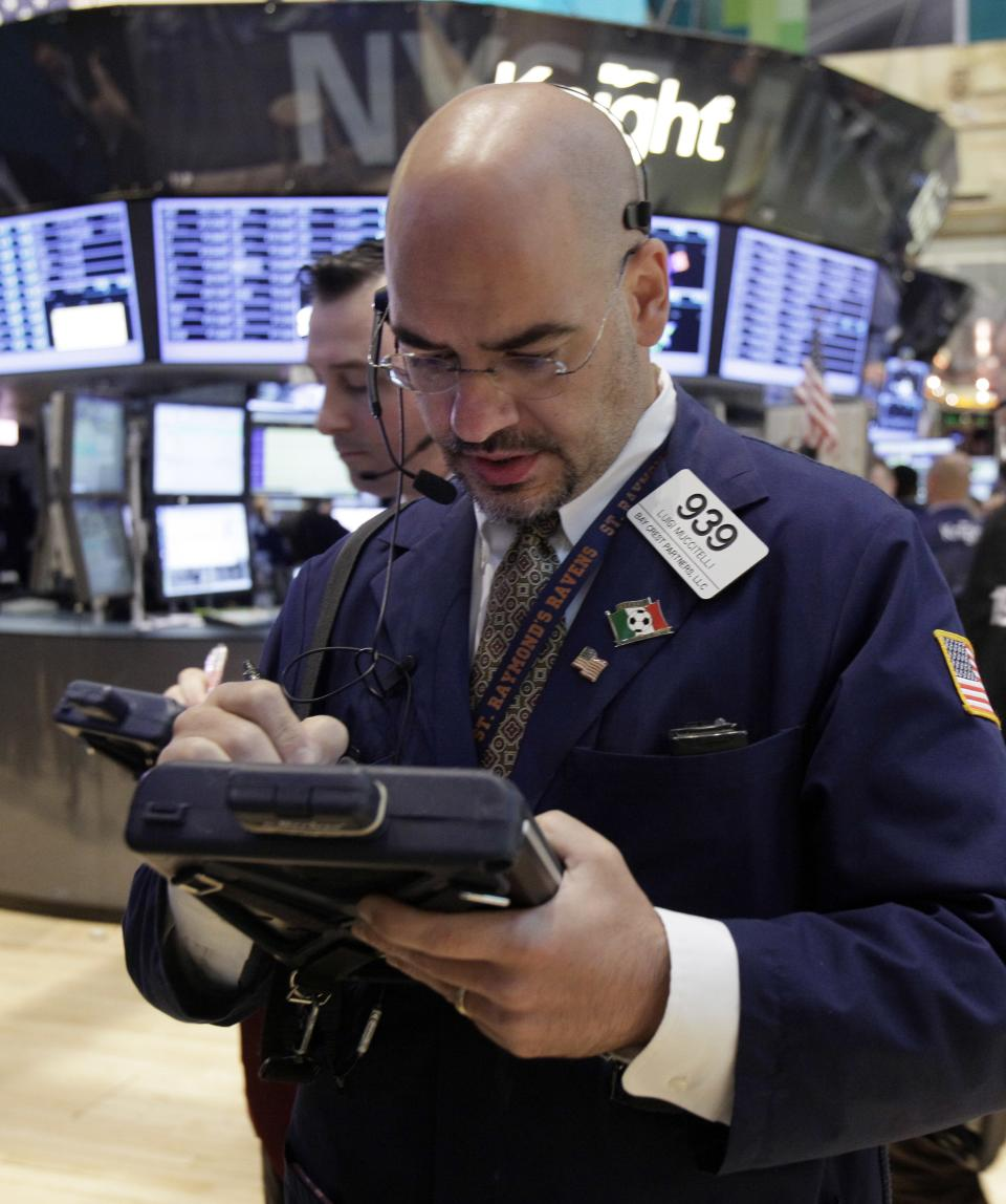 Trader Luigi Muccitelli, right, works on the floor of the New York Stock Exchange Monday, June 18, 2012. U.S. stocks are falling after the opening bell as Europe's debt crisis roils markets despite the victory of a pro-Europe party in Greek elections. (AP Photo/Richard Drew)