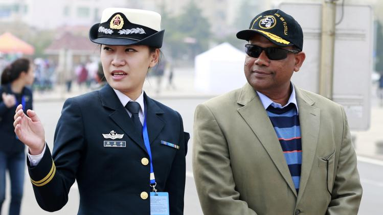 "Commander of Bangladesh's naval frigate ""BNS Abu Bakar"" listens to a Chinese navy officer at a tour during the Western Pacific Naval Symposium in Qingdao"