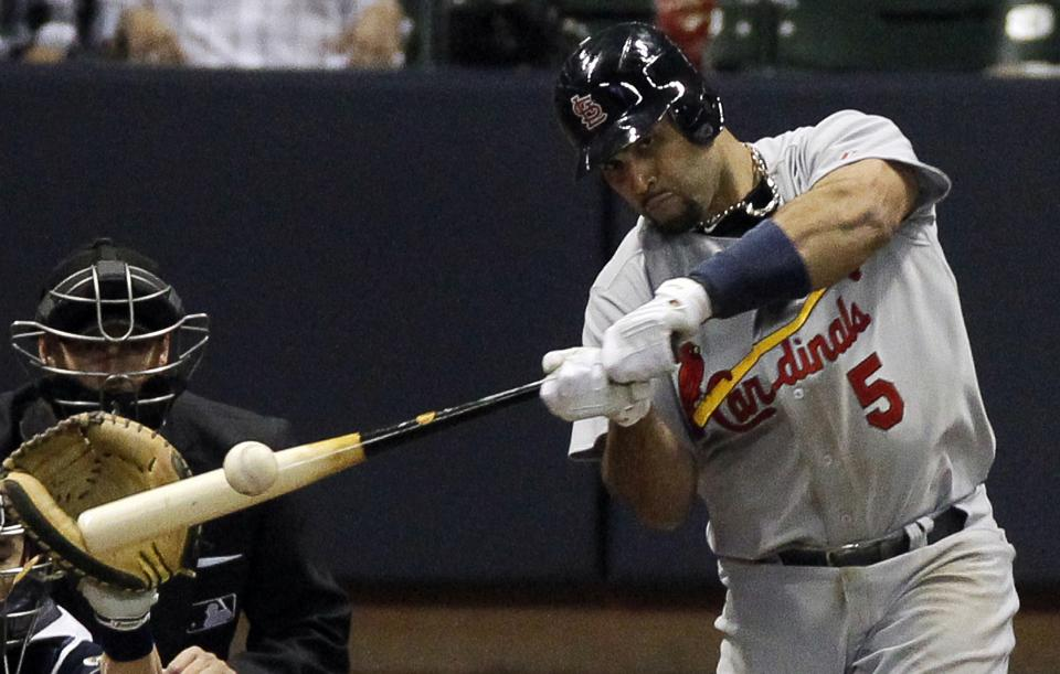 St. Louis Cardinals' Albert Pujols hits an RBI double during the fifth inning of Game 2 of baseball's National League championship series against the Milwaukee Brewers Monday, Oct. 10, 2011, in Milwaukee. (AP Photo/Jeff Roberson)