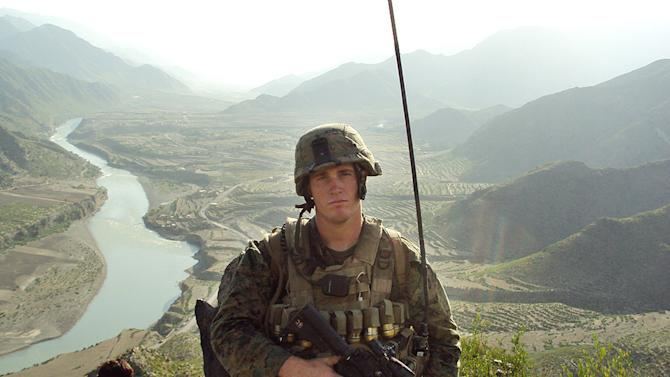 In this undated photo released by the U.S. Marines, Sgt. Dakota Meyer poses for a photo while deployed in support of Operation Enduring Freedom in Ganjgal Village, Kunar province, Afghanistan. The White House announced the 23-year-old Marine scout sniper from Columbia, Ky., who has since left the Marine Corps, will become the first living Marine to be awarded the Medal of Honor in decades for his actions in Afghanistan. (AP Photo/U.S. Marines)