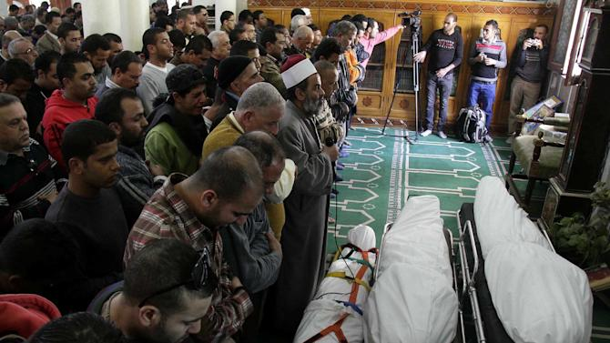 Egyptians say funeral prayers in a mosque for three people who died in demonstrations marking the second anniversary of the January, 25, 2011, Egyptian revolution in Suez, Egypt, Saturday, Jan. 26, 2013. The unrest was the latest in a bout of violence that has left a total of at least 38 people dead in two days, including over 10 killed in clashes between police and protesters marking Friday's second anniversary of the uprising that overthrew longtime leader Hosni Mubarak. (AP Photo/Ahmed Abd El-Latef, Shorouk Newspaper)   EGYPT OUT