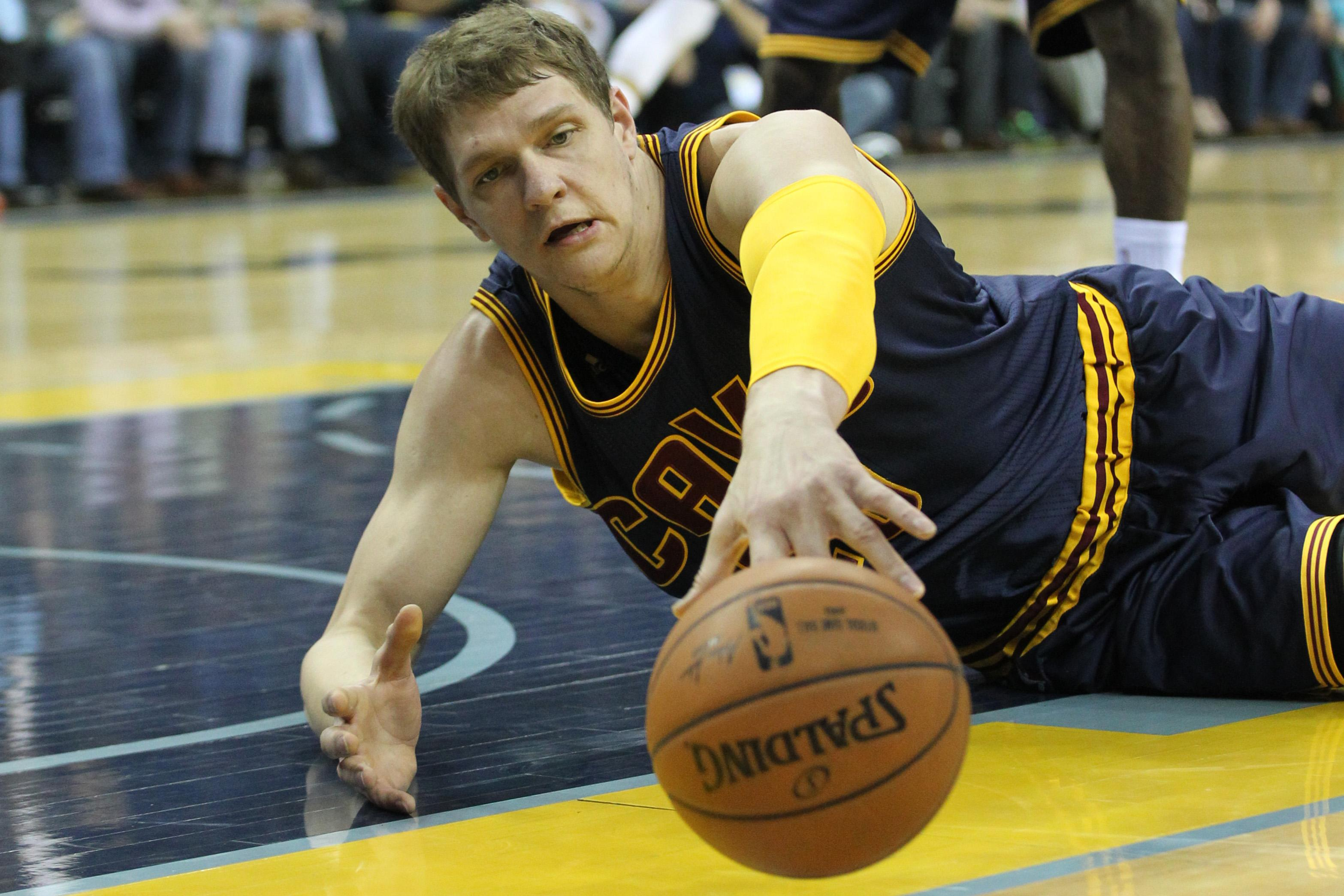 Timofey Mozgov, backward jersey and all, is a natural commercial pitchman