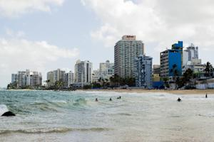 Vacant buildings dot the coast in the upscale Condado …