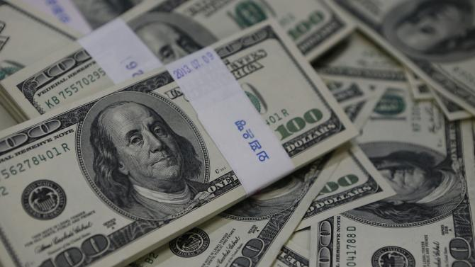 U.S. one-hundred dollar bills are seen in this photo illustration at a bank in Seoul